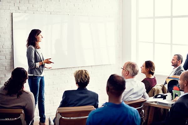 woman leading a group meeting
